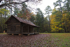 Log Cabin in the Woods. Rustic log cabin in the country royalty free stock image