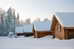 Log cabins under snow in winter Royalty Free Stock Photography