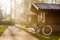 Log cabins and a bicycle Stock Images