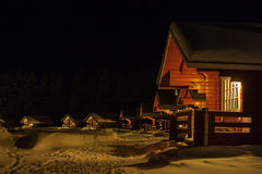 Log cabins in Lapland, Finland. Group of log cabins during the night in Lapland, Finland Royalty Free Stock Images