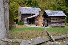 Log Cabins in the Valley. Old Log Farm House and Utility Building in the Valley. Early Appalachian Settlers Royalty Free Stock Images