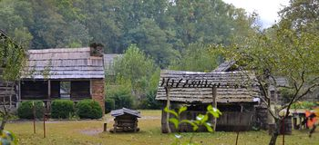Log Cabins in the Valley. Old Log Farm House and Utility Building in the Valley. Early Appalachian Settlers Royalty Free Stock Photo
