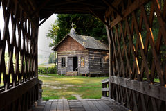 Log church and covered bridge Royalty Free Stock Photo
