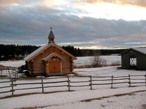 Log church by the highway Royalty Free Stock Image