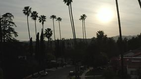 Log drone footage of single-family home American neighborhood at sunset, Los Angeles, California stock video footage