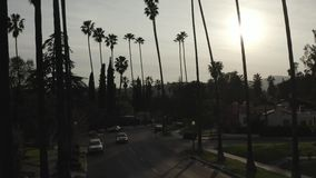 Log drone zoom footage of single-family home American neighborhood at sunset, Los Angeles, California stock footage