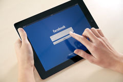 Log In On Facebook App. Facebook launch application for iPad in October 10, 2011 Royalty Free Stock Image
