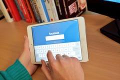 Facebook social network on tablet screen Stock Photos