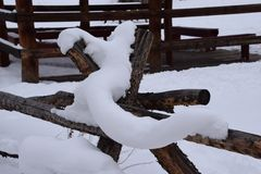 Log fence covered in snow. Log fence under snow Royalty Free Stock Image