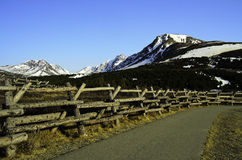 Log fence and path to mountain peak Royalty Free Stock Photography
