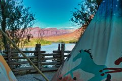 Teepee on the River. Log fence and teepee in late afternoon. Red Cliffs Lodge on the Colorado River offers lodging, dining, and vacation activities. Near Moab stock photos