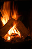 Log fire. Roaring log fire in cottage Royalty Free Stock Photography