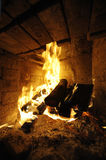 Log Fire. Homely warm log fire. Useful file for your brochure about warm home, restaurnat and hotel services Royalty Free Stock Images