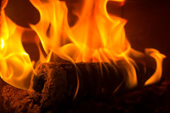 Log on fire burning billets in fireplace Stock Photo