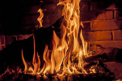 Log in fire. Log is burning in fireplace Stock Photography