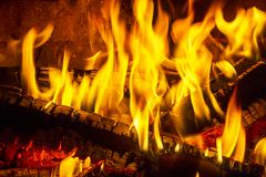 Log fire in a fireplace. Burning and glowing pieces of wood in Fireplace.  Stock Photos