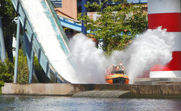 Log flume fairground ride. Log flume theme park funfair ride with splashing water.  Prices to many UK fairgrounds have been reduced due to the recession Stock Photo