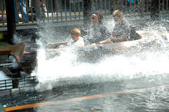 Log Flume ride. Teens getting splashed on Log Flume Ride stock photo
