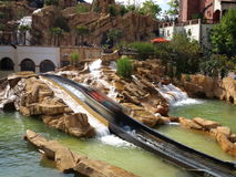 Log flume ride boat speeding in mexican setting Royalty Free Stock Image