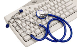 Log On For Health Advice. Blue stethoscope on computer keyboard. White background. Color image stock photography