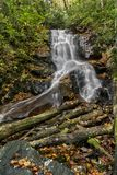 Log Hollow Falls Waterfall. Log Hollow Falls is a scenic 25 foot waterfall in western North Carolina. Seen here in autumn stock images