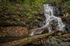 Log Hollow Falls Waterfall. Log Hollow Falls is a scenic 25 foot waterfall in western North Carolina. Seen here in autumn stock photos