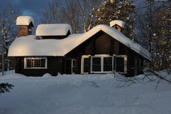 Log home. Beautiful old log home in winter Stock Photos