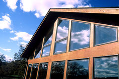 Log Home. Photo of an A frame log home with sky reflecting in the windows Royalty Free Stock Photography