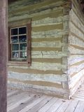 Log Home with window. Front corner view of log home with a stock photos