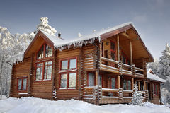 Log Home Winter With Large Windows, Balcony And Porch, Daytime. Stock Photography