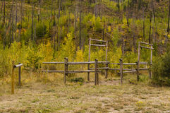 Log horse corral and hitching post Stock Photos