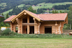 Log house. Wooden log house under construction in Tyrol, Austria. Environmentally friendly building materials Royalty Free Stock Image