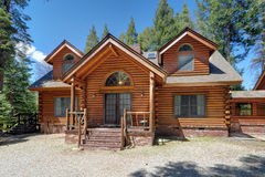 Log house. Left side of a very large log home Royalty Free Stock Image