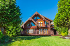 Log house. Beautiful modern log house in the mountains in Canada Royalty Free Stock Images