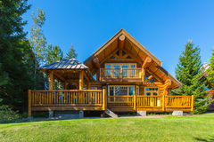 Log house. Beautiful modern log house in the mountains in Canada Stock Photo