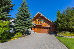 Log house. Beautiful modern log house in the mountains in Canada Royalty Free Stock Photo