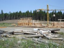 Log house building. A smaller construction site building log houses Stock Photography