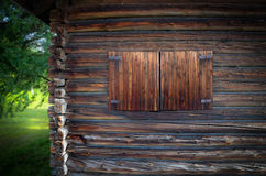 Log house with closed window. Old log house with closed window in Sweden royalty free stock image