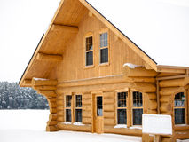 Log house covered in snow. During winter Stock Photos