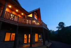 Log House Exterior at dusk