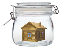 Log house in glass jar Stock Image