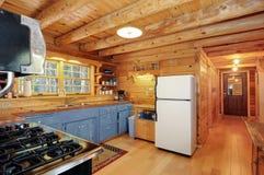 Log house kitchen. Lots of natural wood Royalty Free Stock Photo