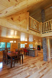 Log house kitchen and dining interior Stock Photos