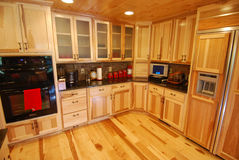 Log house kitchen interior Royalty Free Stock Photo