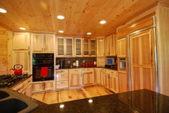 Log house kitchen interior Royalty Free Stock Image