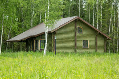 Log house on the outskirts of forest Stock Images