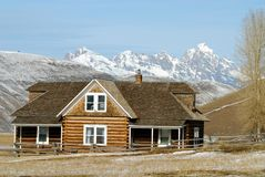 Log House on Prarie. Log House with Grand Tetons in the background Stock Photos