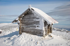 Log house. Small log house on the very peak of the mountain, a shelter for the ski lift staff and visitors, Mt.Kopaonik Stock Photo