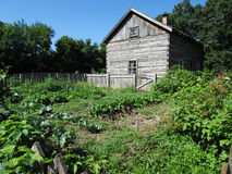 Log House and Vegetable Garden Stock Photo
