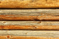 Log house wall texture. Old weathered unpainted logs close-up capture - traditional house wall texture, timber background Stock Photography